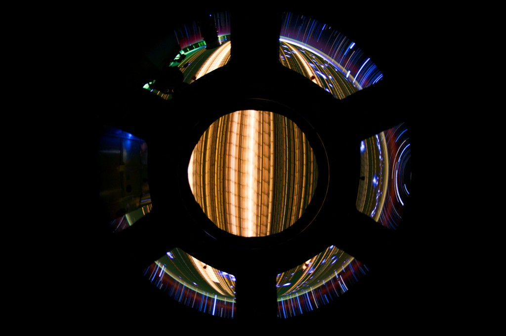 The Earth as a long exposure shot from the faceted International Space Station Window